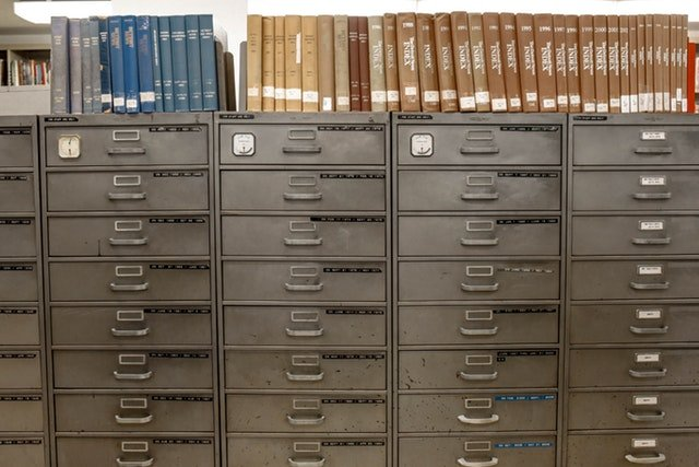 a filing cabinet full of documents that have been processed and cetegorised