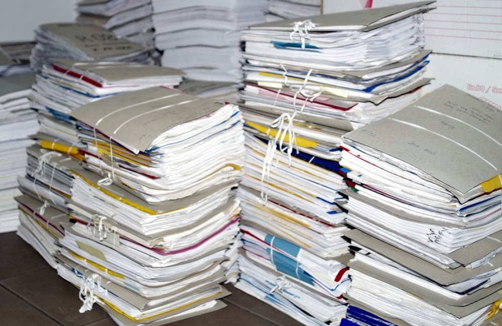 a stack of documents that could be processed to extract valuable sentiment insights