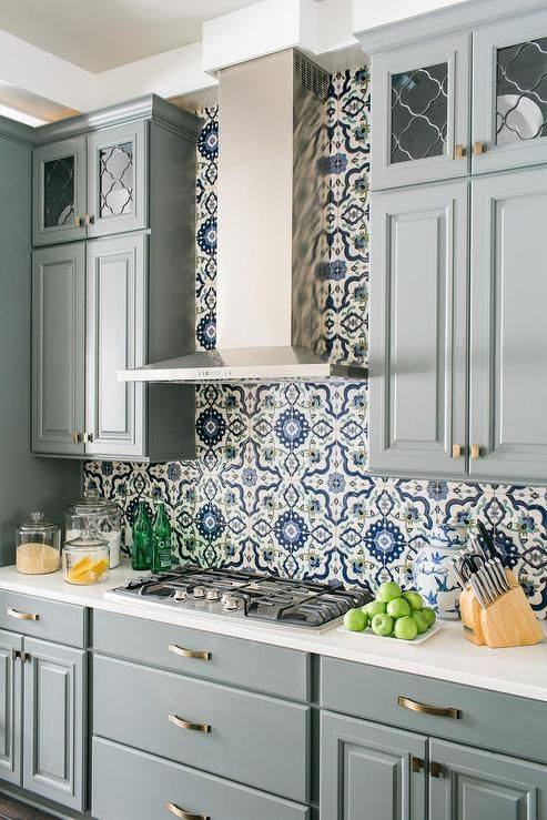 Steel blue cabinets with blue traditional wallpaper and simplistic cabinet hardware