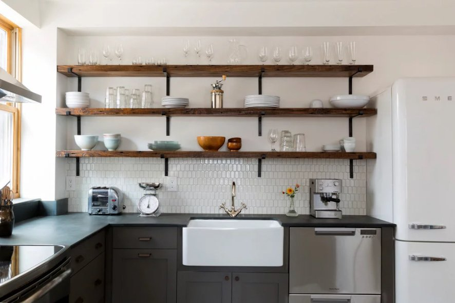 unique-kitchen-with-modern-black-counters-old-fashioned-fridge-and-basin-sink-with-mixed-metal--hardware-accents