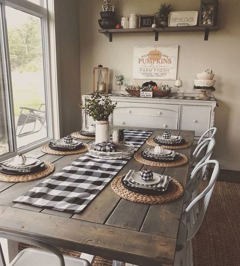 rustic-farmhouse-table-with-plaid-place-settings-and-heirloom-buffet
