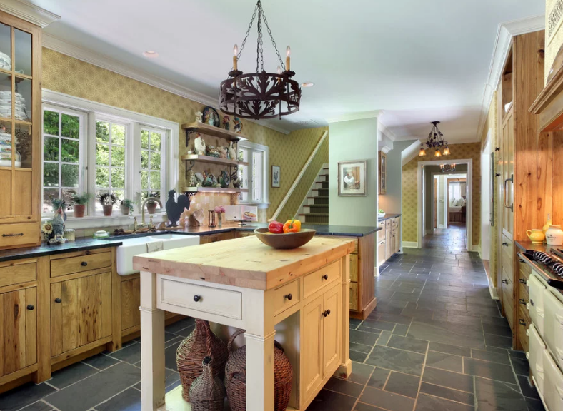 Butcher-block-island-with-wood-cabinets-traditional-cabinet-hardware-and-tile-floors-for-a-perfect-farmhouse-style