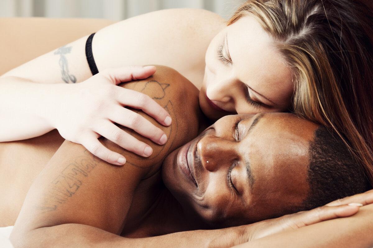 anal sex biracial hetero couple cuddling in bed