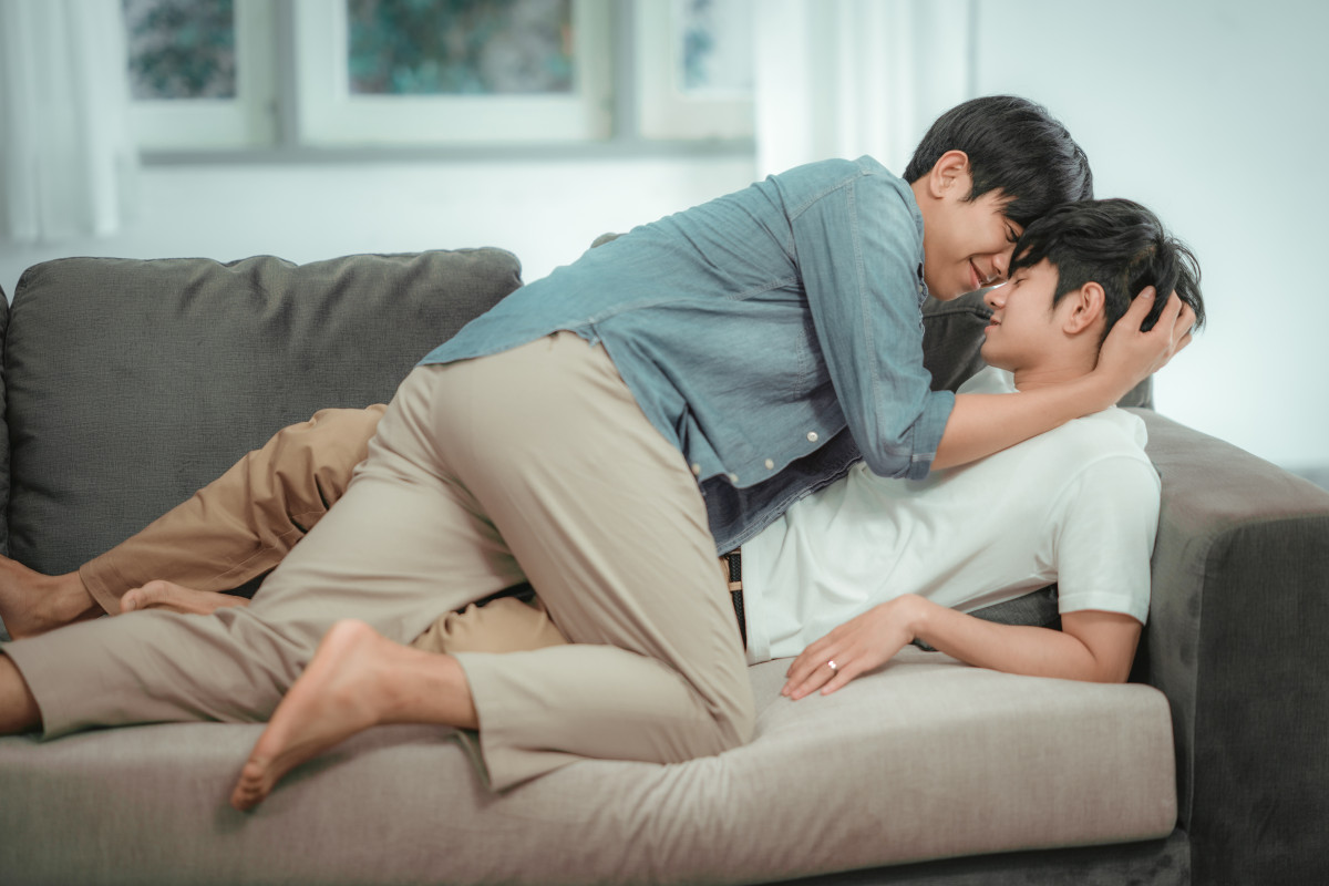 foreplay gay couple on couch kissing