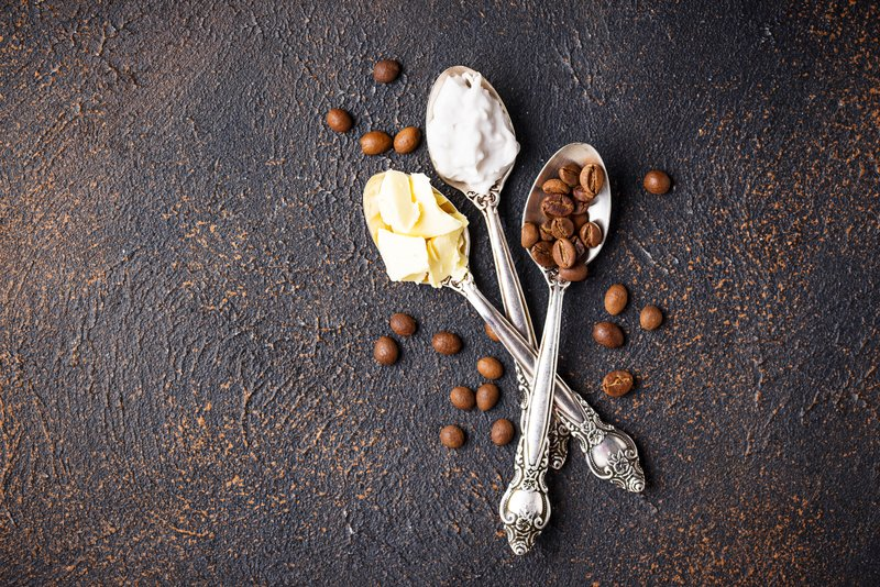 MCT oil, butter and coffee in spoon