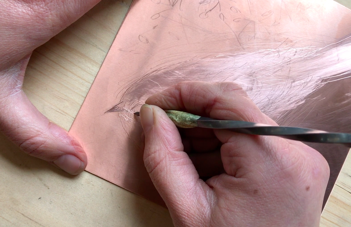 scratching the copper plate - video still