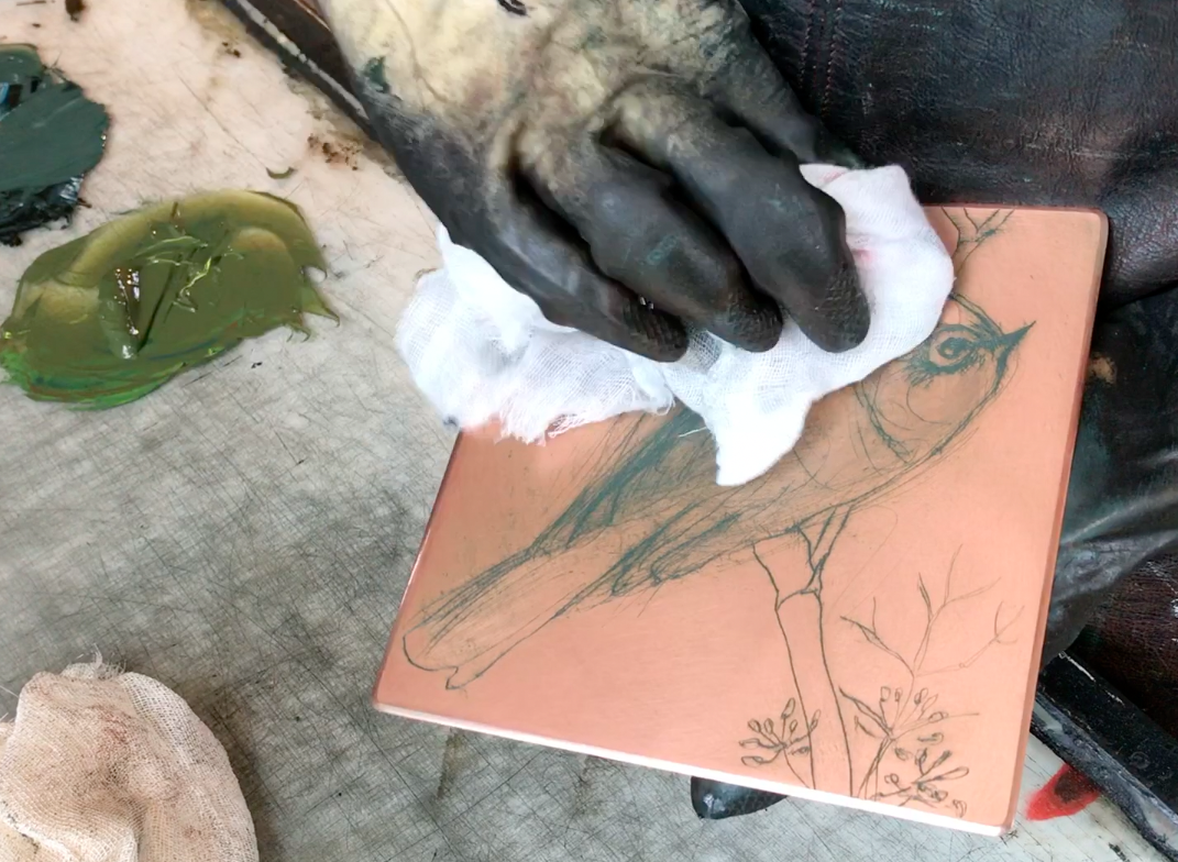 video still - inking up the etched plate
