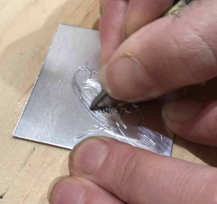 scratching the image int the aluminium plate