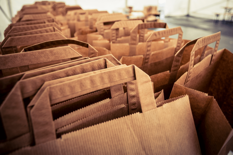 paper bags require four times more raw materials and create 50 times more water pollution than plastic bags