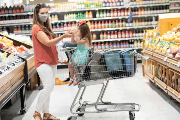 socially distance and wear a mask while grocery shopping to keep you and others safe from Covid-19