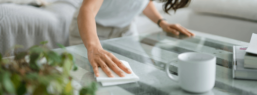 Wiping countertop with disinfectant wipe