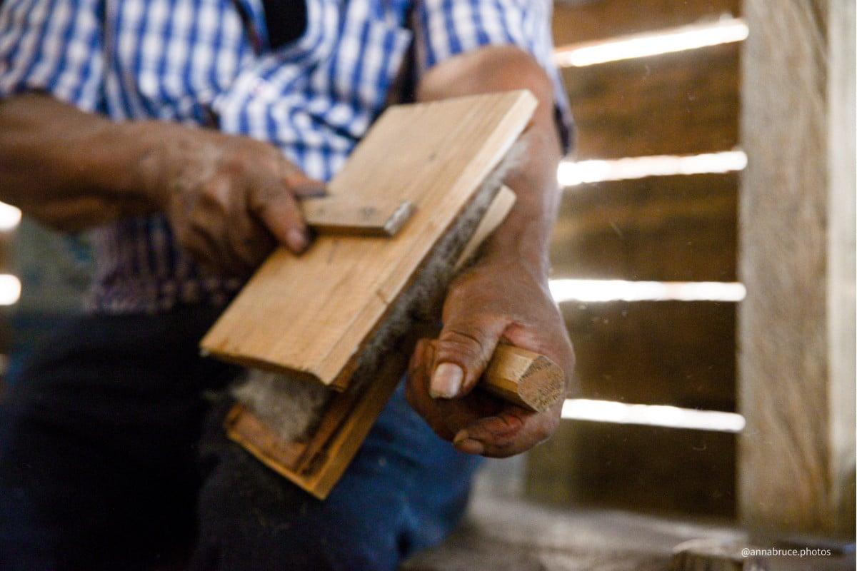 Wool carding by artisans in Oaxaca.