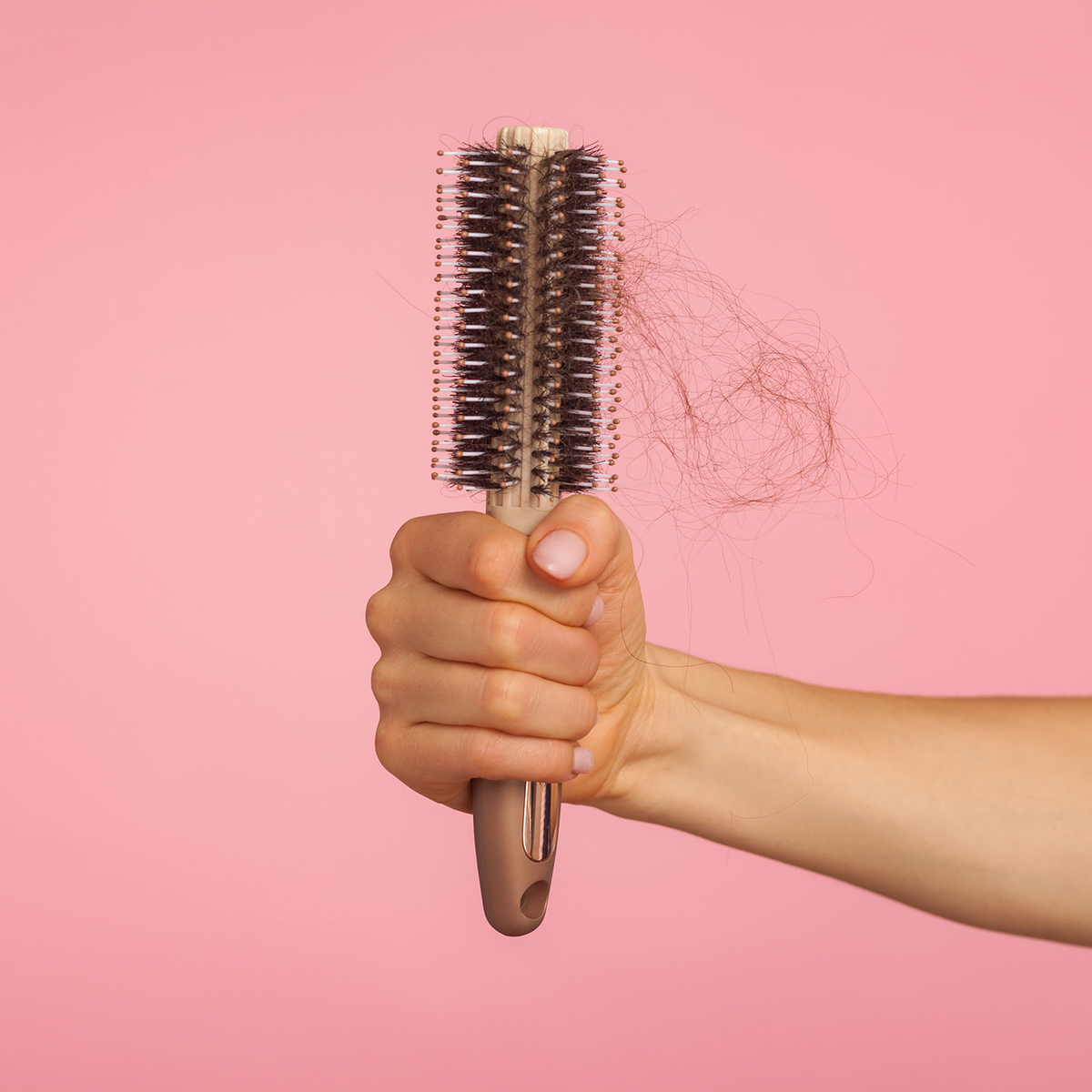 Picture of hand holding hair brush