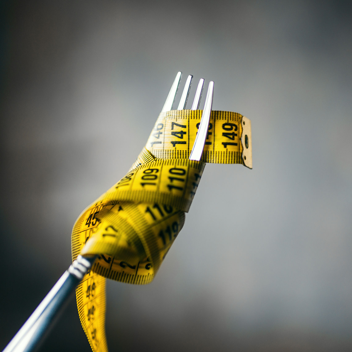 Picture of a tape measure wrapped around a fork