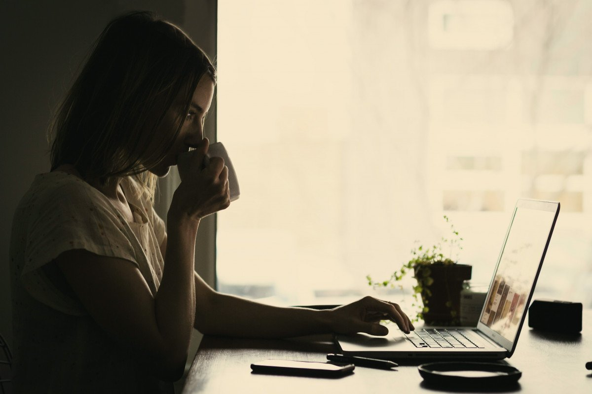 Fully-stocked coffee drinker working at home