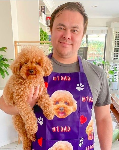 funny apron dad wearing apron with dog