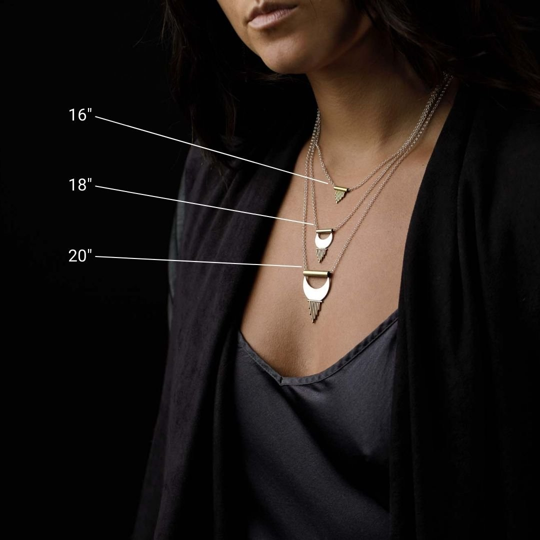 Wearing 3 layering necklaces to show various necklace lengths