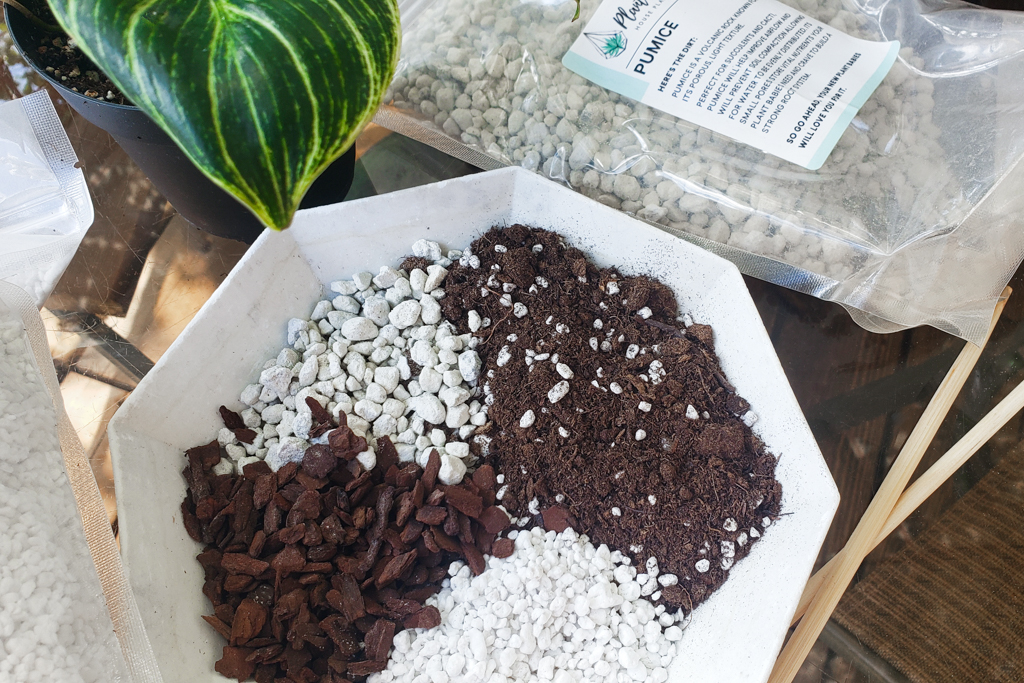 a photo of a tray containing house plant soil, bark fines, perlite, and pumice