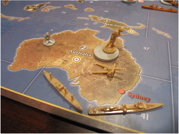Axis and Allies map with various game pieces