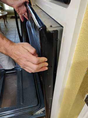 How to remove a control board from a built-in wall oven - slide the unit out form the wall step one