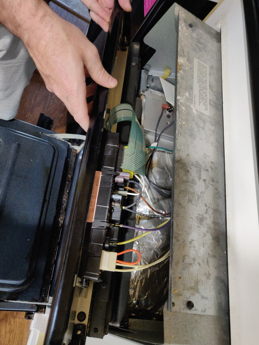 How to remove a control board from a built-in wall oven - Drop down the control panel