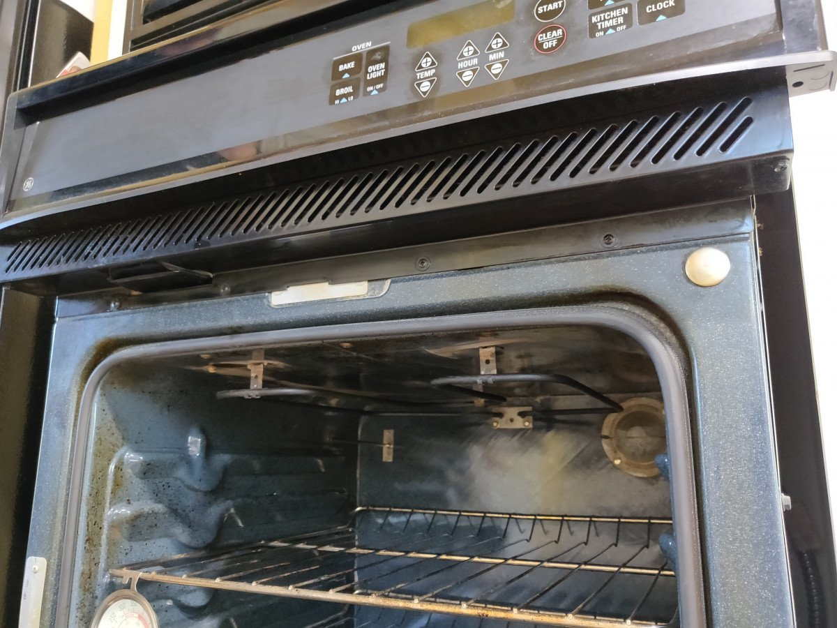 How to remove a control board from a built-in wall oven - Remove the side trim and panel screws