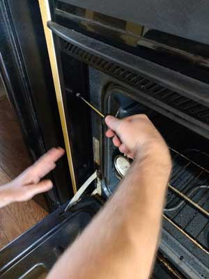 How to remove a control board from a built-in wall oven - undo screws