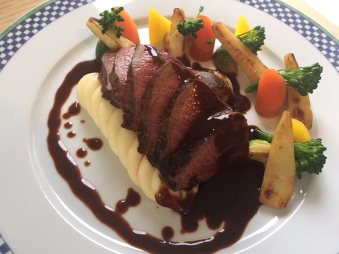 Pan seared venison loin with a red wine and dark chocolate jus