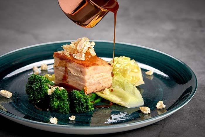 Sous vide belly pork and seasonal vegetables