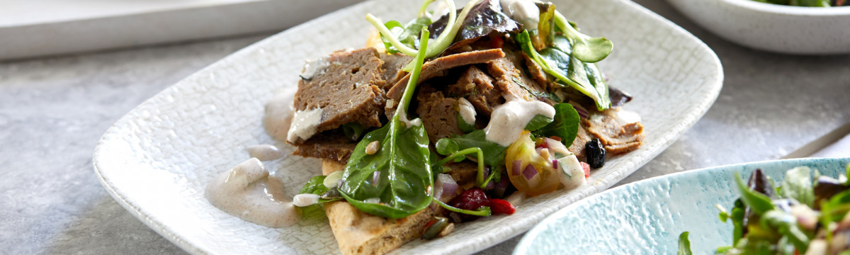 Lamb Kofta pitta bread with cinnamon infused tzatziki, pear and peppermint salad