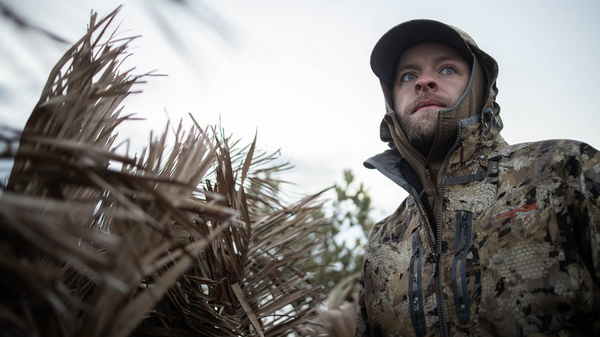 Casey Smith targets ducks in pockets of open water on a frozen marsh as birds migrate south from the Great Lake Lake in Utah