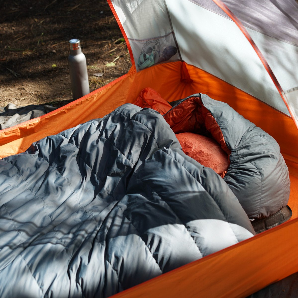 Down vs. Synthetic The Best Sleeping Bag For YOUR Moto Camping Adventures