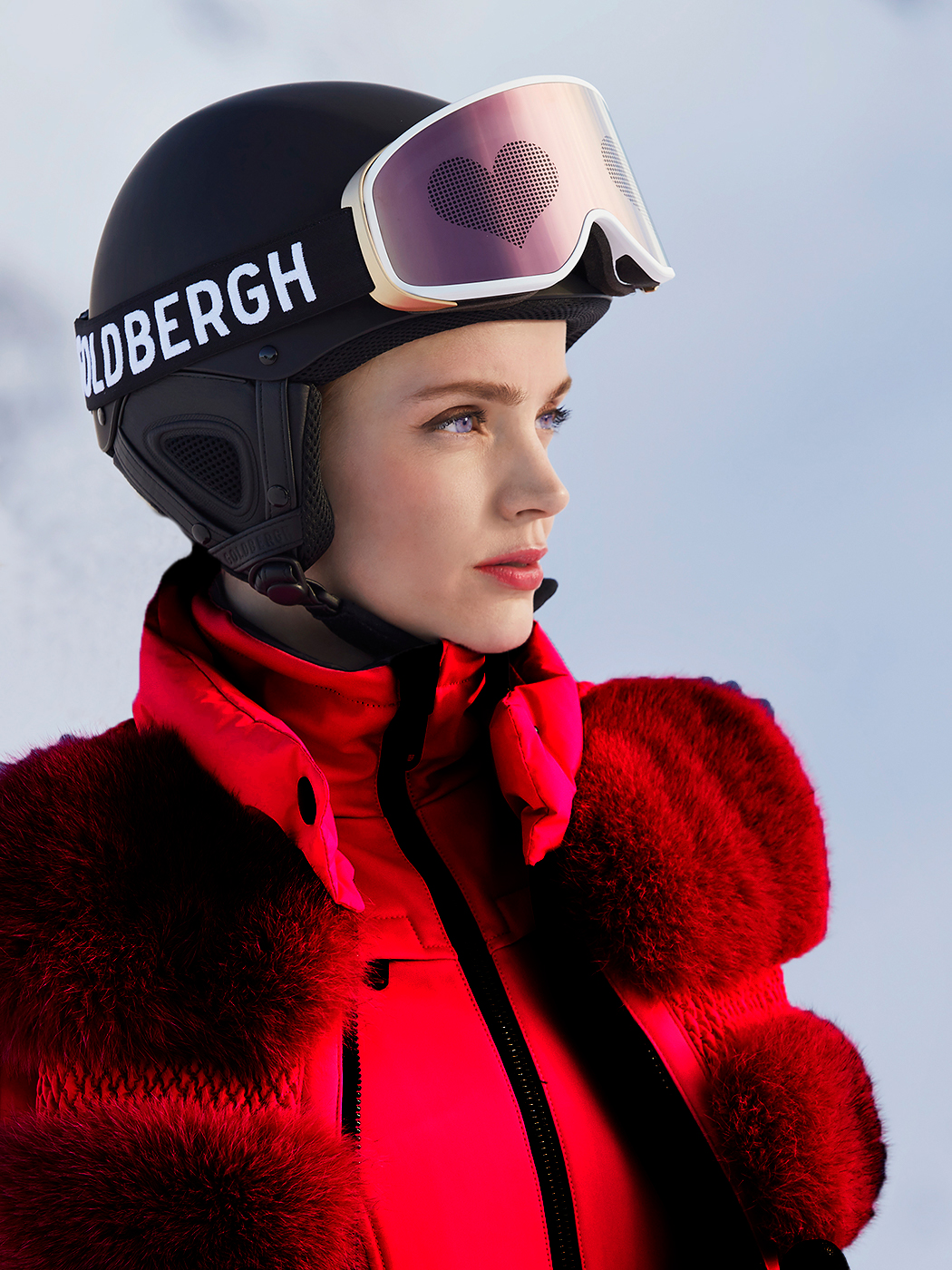 Foxy faux fur red gilet by Goldbergh worn with the Phoenix ski suit in red